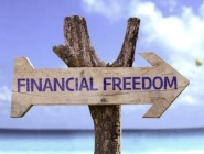 Financial Freedom wooden sign with a beach on background -663286-edited.jpeg